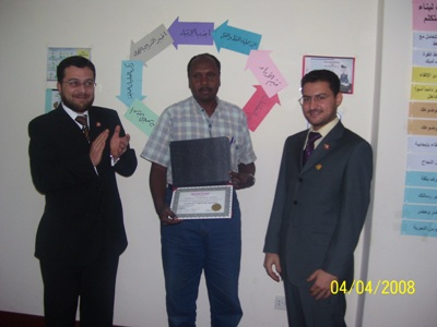Trainee Awadalla Babker is receiving his certificate