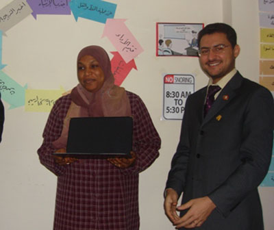 Trainee wisal Hamed and the trainer Mohammad Pedra while distributing the certificates