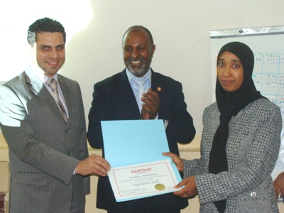 Trainee Lubna Ehmaidato is receiving her certificate
