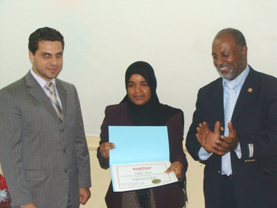 Trainee Najat Azizy is receiving her certificate