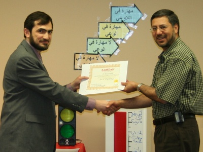 Dr. abdelrazzaq kawmeleh is receiving his certificate from Dr. muhannad Alferhan-the manager of ILLAFTrain-Chicago