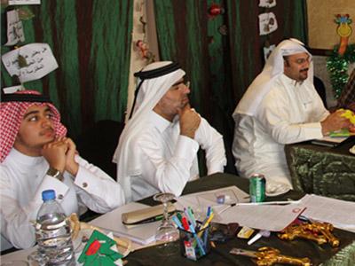 listening to the trainer Jawaher Al-Mane' while explaining the exercise idea