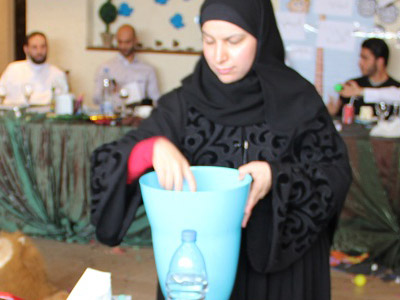 trainer Jawaher Al-Mane' helping the trainees and distribute the balls on them
