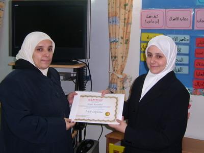 Trainee Najat Kanadeel is receiving her certificate