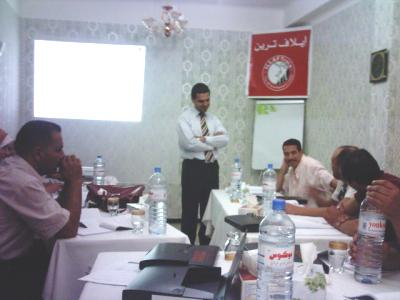 Trainer Basel Alnassar is having a discussion with the trainees