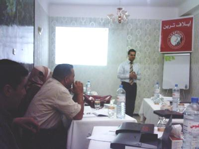 Trainer Basel Alnassar and a side of the trainees during the course