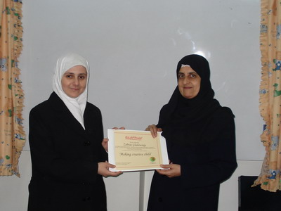 Trainee Zahraa Ghlawangi is receiving her certificate