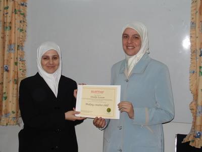 Trainee Khadeja Kassam is receiving her certificate