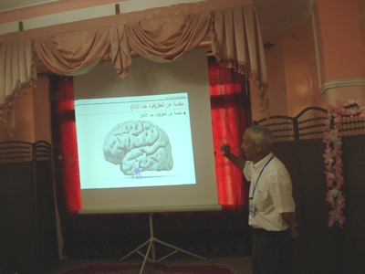 Dr. Ramadan is presenting a practical explanation of the brain