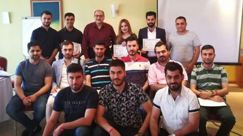 صورة للمدرب د. سعيد مع فريق شمال العراق